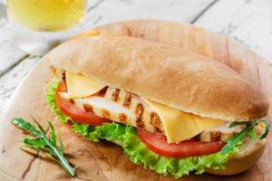 Sandwich with grilled chicken and tomatoes cheese