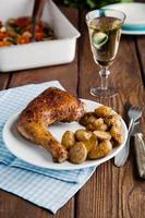 Chicken drumstick with potatoes