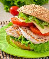 Chicken sandwich with salad and tomato
