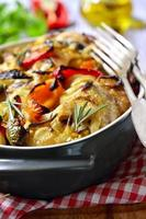 Chicken baked with bell pepper and onion.