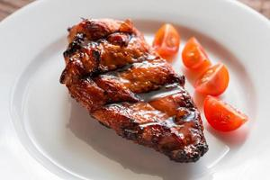 Grilled chicken steak with cherry tomatoes