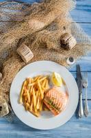 Homemade salmon with chips with lemon