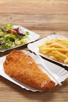 Fried fish and chips on a paper tray photo