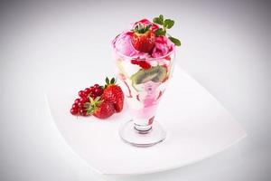 Strawberry ice cream with fresh fruits