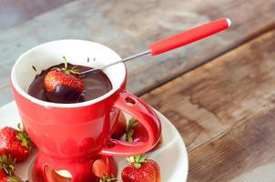 Chocolate dipped strawberries fondue