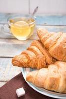 croissant with tea photo