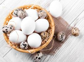 Quail and chicken eggs in a wicker basket
