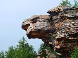 Huge rock bizarre, like a turtle photo