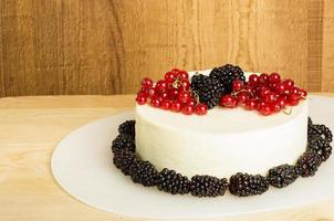 White cheddar cheese block with currants and blackberries photo