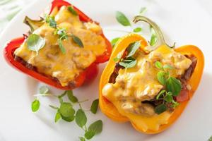 stuffed colorful peppers with meat cheese vegetables photo