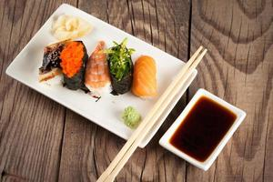 fresh sushi on wooden background