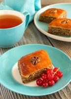 Homemade baklava with a cup of tea.