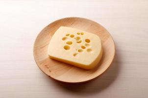 Cheese on wooden plate
