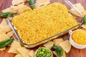 bean dip with jalapenos, sour cream and cheddar cheese
