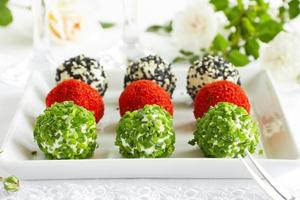 Snack-balls of goat cheese with spices. photo