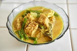 verduras con sopa de leche de coco foto