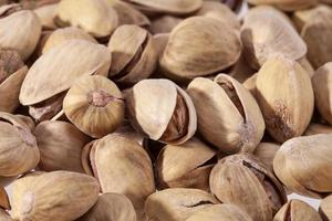 background of dried pistachios close up