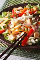 Dietary salad with tofu and fresh vegetables vertical