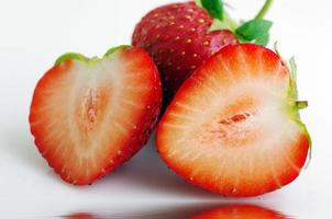 Healthy red strawberry fruit sliced isolated on the white backgr
