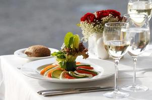 Caprese salad with tomatoes, mozzarella and basil. photo