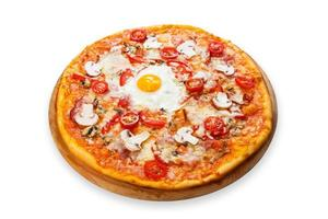 Delicious pizza with mushrooms, bacon and egg