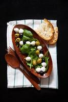 fresh light healthy summer salad with spinach, green olives photo