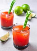 Bloody Mary cocktail with celery, pepper, sea salt