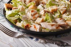 Caesar salad with grilled chicken close-up, horizontal