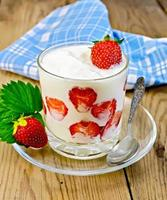 Yogurt thick with strawberries on a board