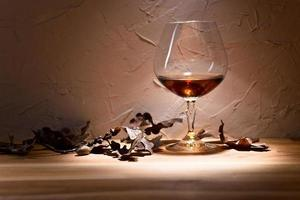 brandy and dried oak leaves photo
