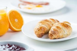delicious breakfast with croissants and juice