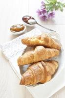 Croissants on table with jam photo