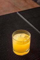 Screw driver cocktail on a bar ribber mat