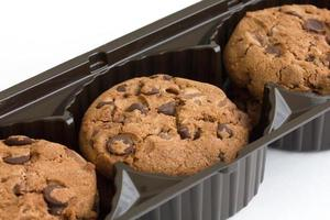 Commercial chocolate chip cookies in plastic tray. photo