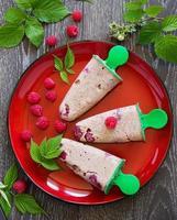 chocolate-coffee ice cream with raspberries. photo