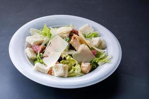Healthy Grilled Chicken Caesar Salad with Cheese and Croutons on