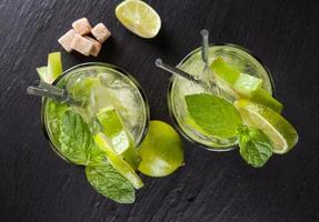 Mojito drinks on stone, upper view