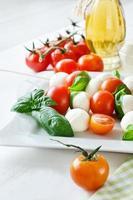 Mozzarella balls with basil, tomatos and balsamic, caprese photo
