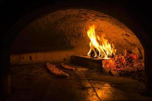 Cooking pide in a stone oven photo