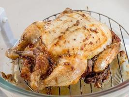 Roast chicken in oven photo