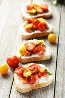 Tasty fresh bruschetta with tomatoes on grey wooden background