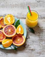 Fresh orange juice and sliced orange photo