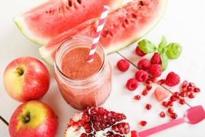 Fresh organic red smoothie with apple, watermelon, pomegranate,