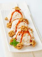 Walnut ice cream with caramel sauce