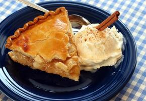 Close-up of apple pie ala mode on a blue plate photo