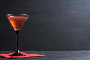 Red cocktail in martini glass photo