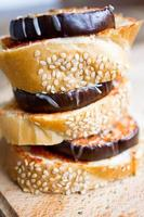 Appetizers of bread with eggplant with cheese and tomatoes photo