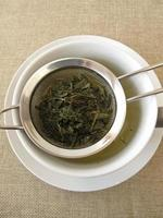 Green tea in tea strainer