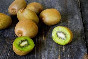 Fresh kiwi on the wooden table, sliced kiwi fruit.
