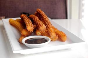 Traditional Spanish Churros served with dark chocolate dipping